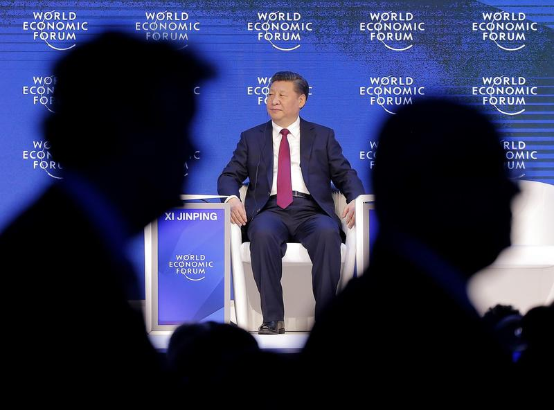 China's President Xi Jinping sits on the podium while people leave at the World Economic Forum in Davos, Switzerland, Tuesday, Jan. 17, 2017. (Michel Euler/AP)