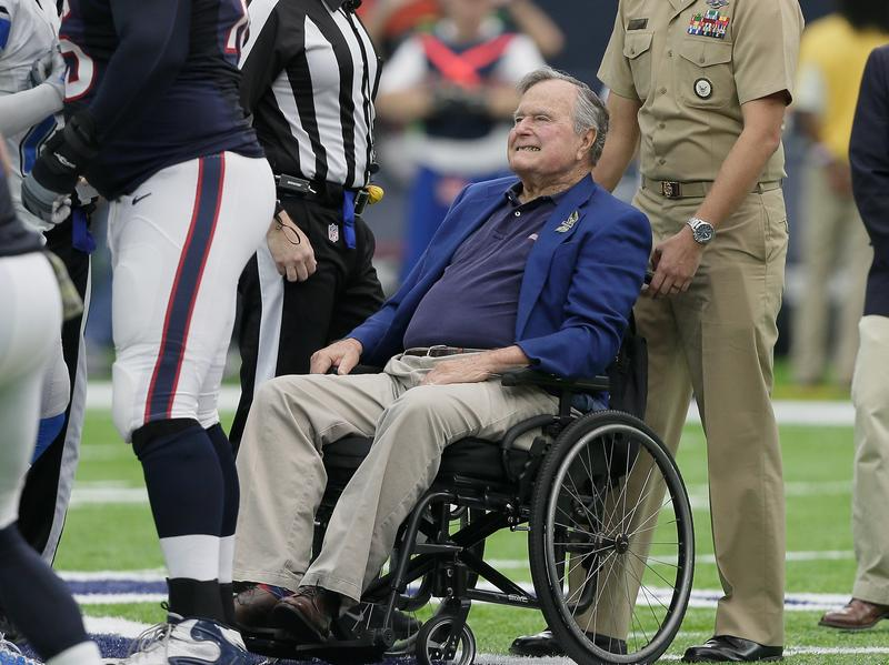 Former President George H.W. Bush flipped the coin for the kickoff between the Detroit Lions and Houston Texans at NRG Stadium in Houston on Oct. 30, 2016.
