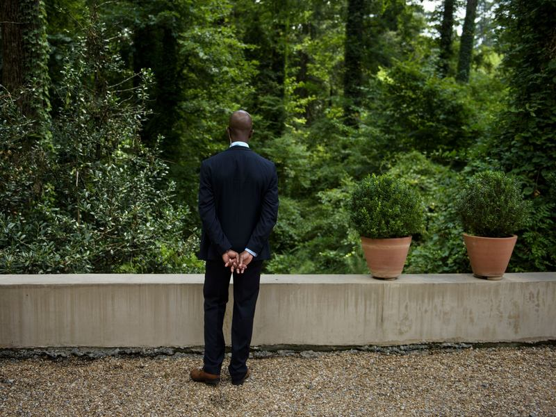 A member of the Secret Service stands guard while President Obama attends a fundraiser for Hillary Clinton in August 2016 in College Park, Ga.
