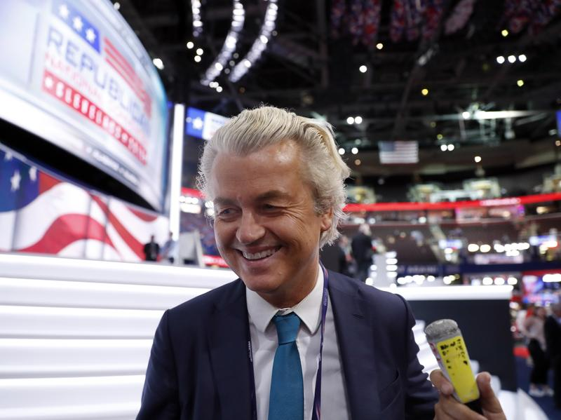 "Dutch lawmaker Geert Wilders talks to reporters at the Republican National Convention in Cleveland in July. The Dutch press has dubbed Wilders ""the Dutch Donald Trump"" because of his rhetoric against immigrants."