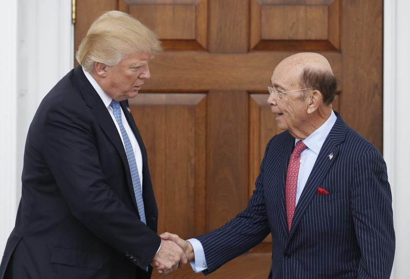 President-elect Donald Trump, left, shakes hands with investor Wilbur Ross after meeting at the Trump National Golf Club Bedminster clubhouse, Sunday, Nov. 20, 2016, in Bedminster, N.J.. (Carolyn Kaster/AP)