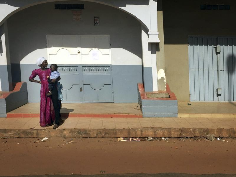A woman looks down an empty street Wednesday in Banjul, Gambia, hours before the end of longtime leader Yahya Jammeh's mandate.