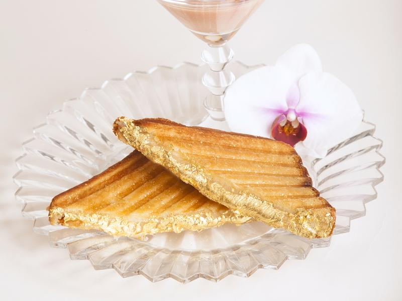"""New York City restaurant Serendipity 3 makes the """"Quintessential Grilled Cheese Sandwich,"""" made with gold leaf, accompanied by the gold-adorned South African Lobster & San Marzano Tomato Bisque, for sandwich-dipping, of course."""