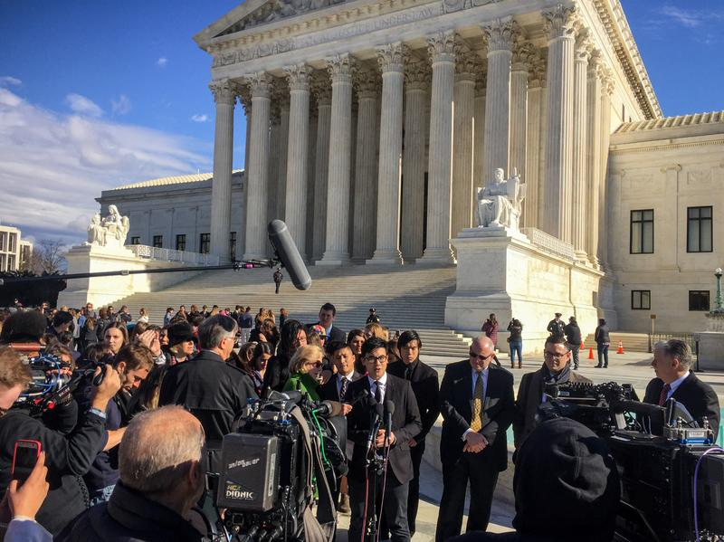 Simon Tam, a member of the band The Slants, speaks to reporters outside the Supreme Court on Wednesday.