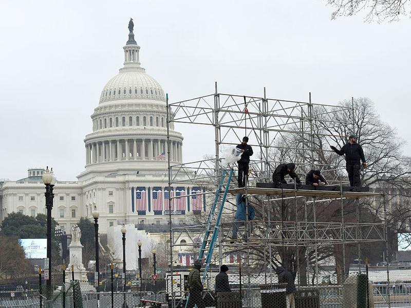 Workers prep a stage for the inauguration of Donald Trump on Capitol Hill on Jan. 17.