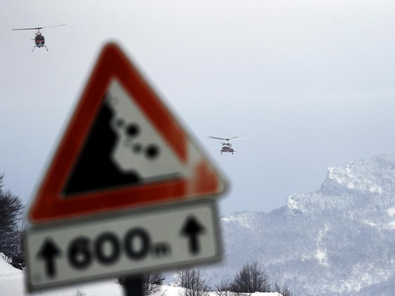 On Friday, Italian rescue helicopters approach the area of the Hotel Rigopiano, which was buried by an avalanche on Wednesday, to help airlift out some people found alive in the debris.