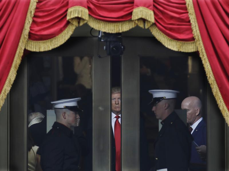 President-elect Donald Trump waits to step out onto the portico at the West Front of the U.S. Capitol for his inauguration.