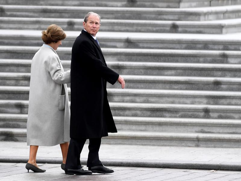 Former President George W. Bush and former first lady Laura Bush depart after the inauguration ceremonies at the U.S. Capitol on Friday.
