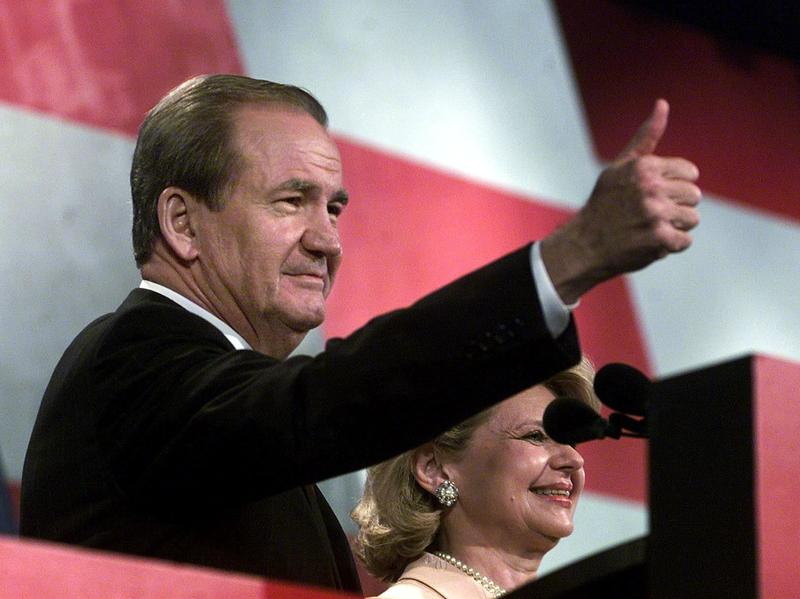 Reform Party presidential candidate Pat Buchanan, flanked by his wife Shelly, gives the thumbs-up to supporters after his speech at the Reform Party National Convention in Long Beach, Calif. in August 2000.