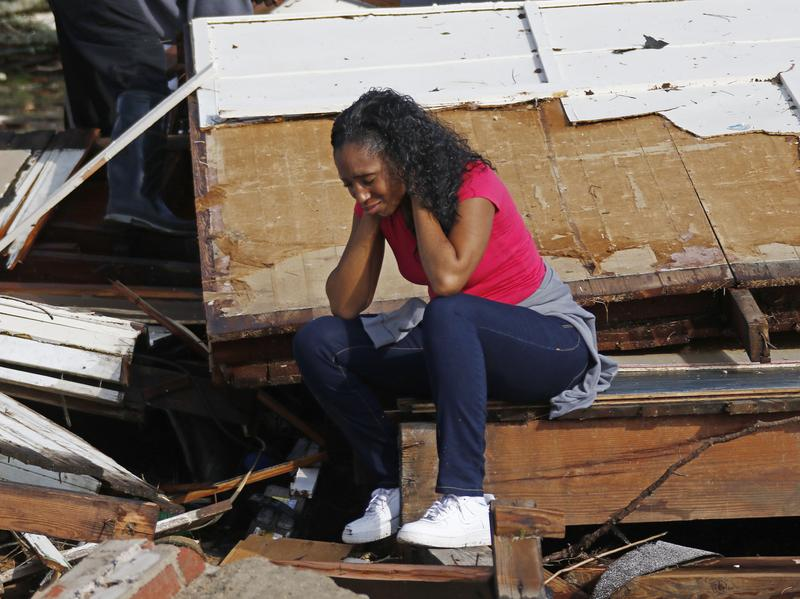Shanise McMorris grieves on the slab of her Hattiesburg, Miss., home after an early tornado hit the city on Saturday.