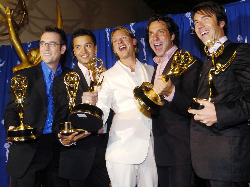 From left: Ted Allen, Jai Rodriguez, Carson Kressley, Thom Filicia and Kyan Douglas celebrate <em>Queer Eye for the Straight Guy</em>'s 2004 Emmy win for outstanding reality program.