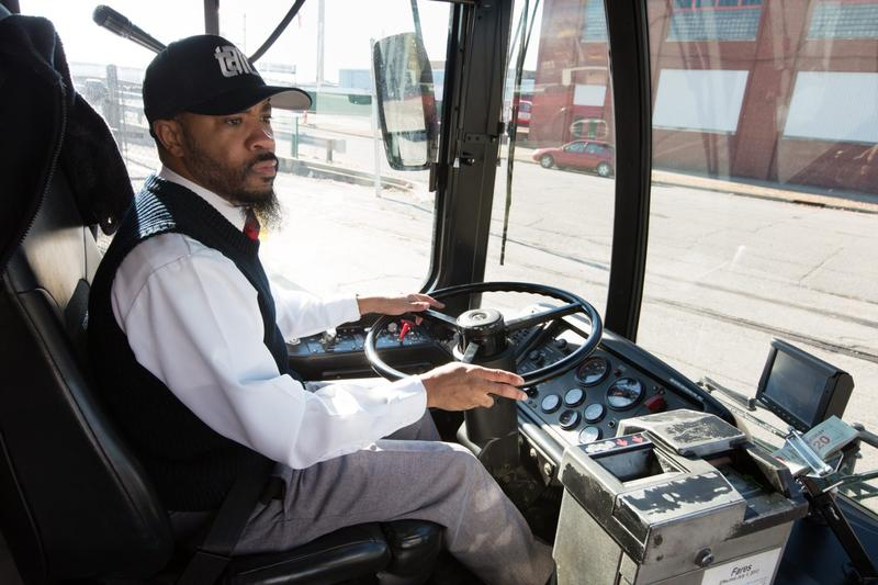 R.G. Williams behind the wheel of a city bus in Louisville, Ky. (Jacob Ryan/WFPL)