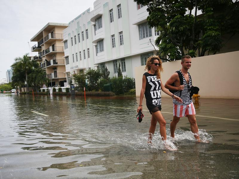 "Government scientists are working on a climate assessment that among other things will help predict ""sunny day"" floods like this one in Miami Beach, Fla., in 2015."