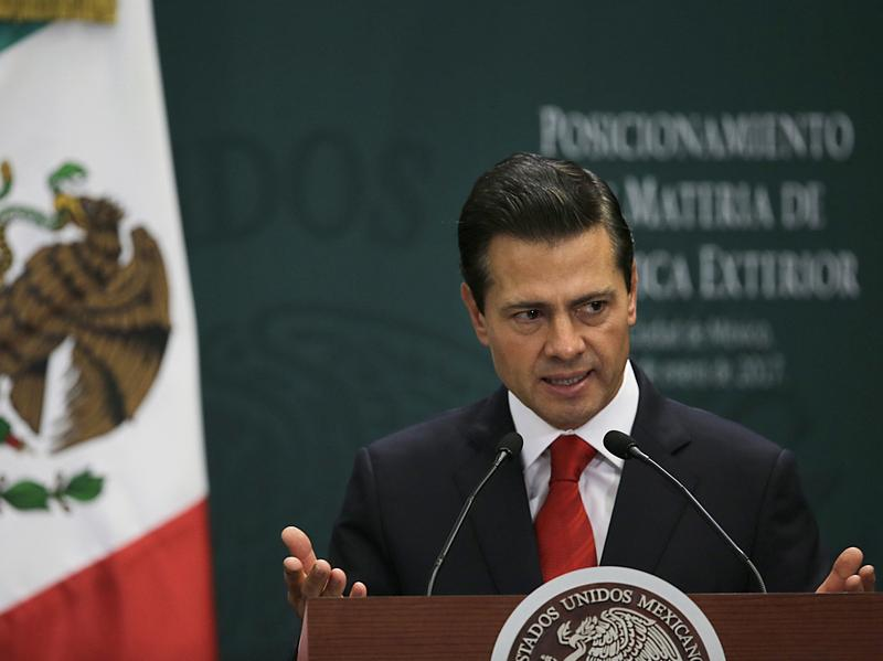 Mexico's President Enrique Peña Nieto speaks during a news conference in Mexico City on Monday. He is waiting to hear from high-level negotiators before deciding whether to cancel his U.S. trip.