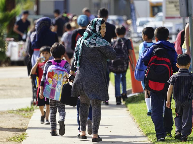 Parents pick up their children at Naranca Elementary in El Cajon, Calif., in October 2016. The school is one of many in the San Diego suburb that has received an influx of Syrian refugees.