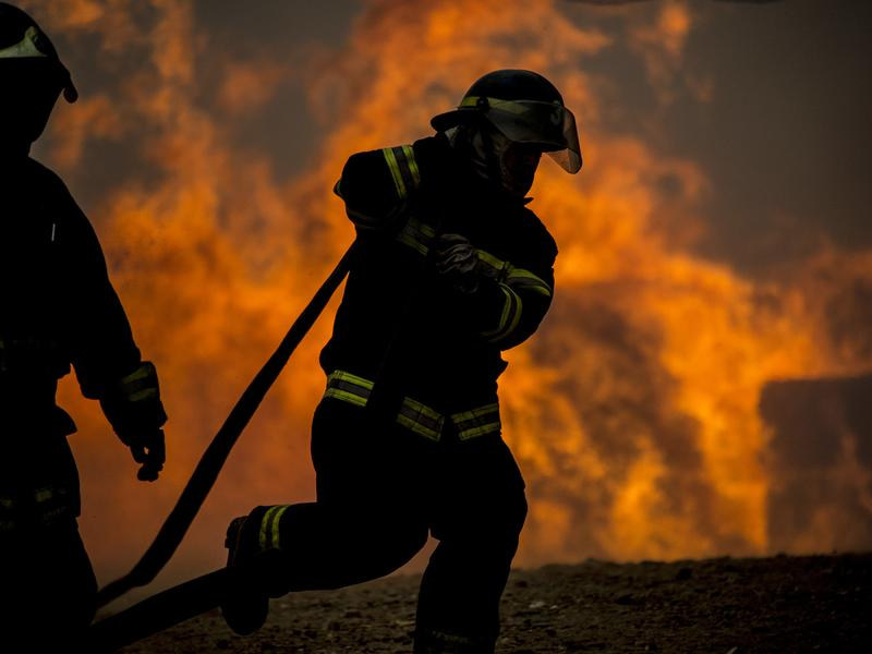 Firefighters work to put out a forest fire in Constitucion, Chile, on Thursday.