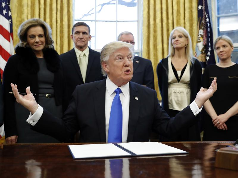 President Trump pauses before signing one of three executive actions in the Oval Office, Saturday.