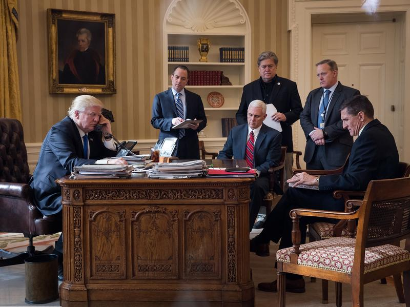 President Donald Trump speaks on the phone with Russian President Vladimir Putin in the Oval Office of the White House, Jan. 28, 2017 in Washington, D.C. Also pictured, from left, White House Chief of Staff Reince Priebus, Vice President Mike Pence, White House Chief Strategist Steve Bannon, Press Secretary Sean Spicer and National Security Advisor Michael Flynn.