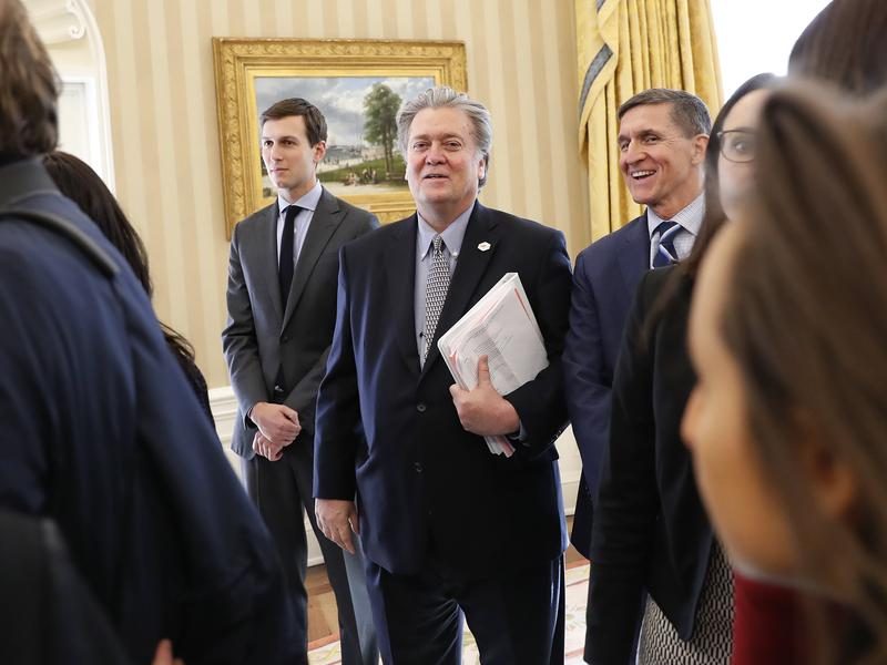 White House senior advisers Jared Kushner (from left), Steve Bannon and national security adviser Michael Flynn are seen in the Oval Office of the White House in Washington on Friday.