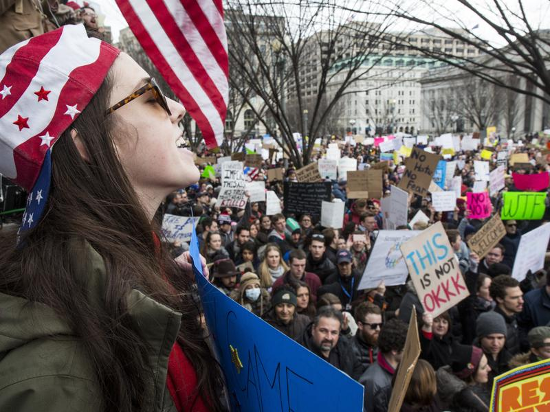 Demonstrators gather near the White House to protest President Trump's temporary immigration freeze on Sunday.