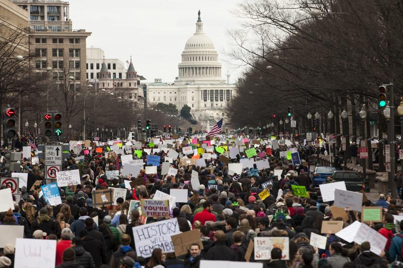 Demonstrators march down Pennsylvania Avenue during a protest on Jan. 29, 2017 in Washington. Protestors in Washington and around the country gathered to protest President Donald Trump's executive order barring the citizens of Muslim-majority countries Iraq, Syria, Iran, Sudan, Libya, Somalia and Yemen from traveling to the United States. (Zach Gibson/Getty Images)