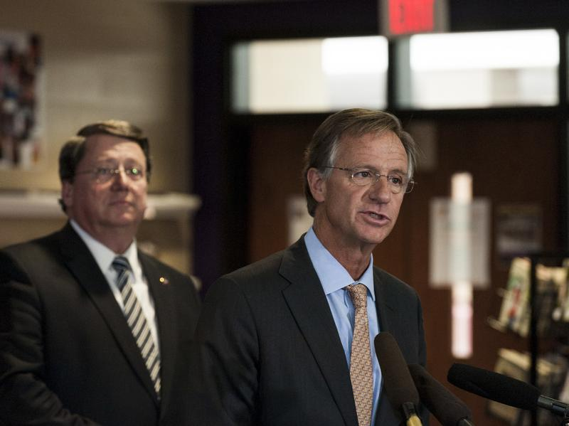 Tennessee Governor Bill Haslam (right) speaks at Cane Ridge High School while Senator Mark Norris looks on. A recent audit found that one in three high school graduates hadn't fulfilled the state's graduation requirements.