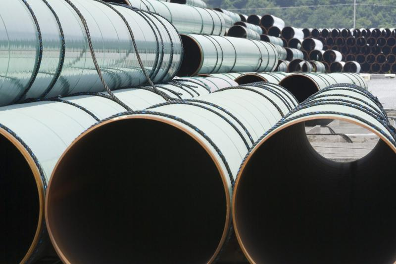 Some of about 500 miles worth of coated steel pipe manufactured by Welspun Pipes, Inc., originally for the Keystone oil pipeline, is stored in Little Rock, Ark., Thursday, May 24, 2012. (Danny Johnston/AP)