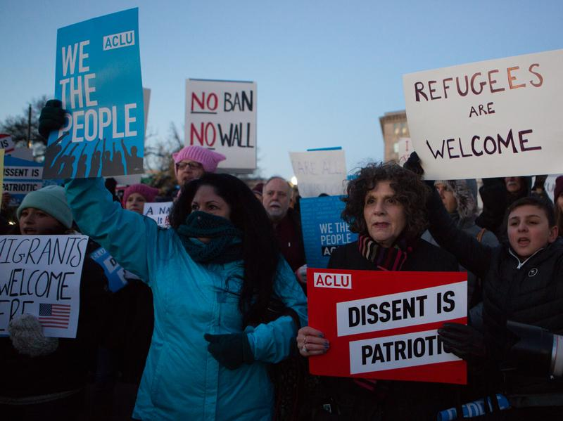 Demonstrators protest outside the Supreme Court against President Trump and his administration's travel ban. Democrats addressed the crowd, but the protesters are putting pressure on them, too.