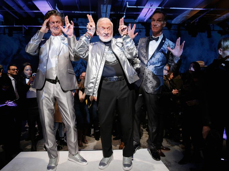 Designer Nick Graham, astronaut Buzz Aldrin and scientist Bill Nye pose on the runway at Graham's New York Fashion Week show.