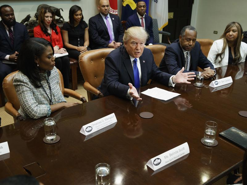 """President Trump, flanked by Omarosa Manigault and House and Urban Development Secretary nominee Ben Carson, holds an African-American History Month """"listening session"""" on Wednesday."""