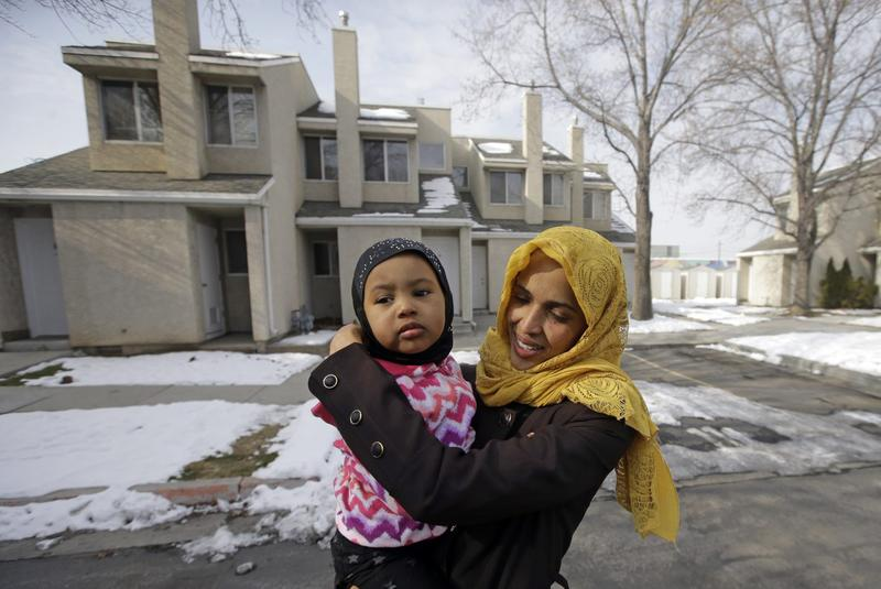 Somali refugee Nimo Hashi hugs her daughter Taslim at their home Tuesday, Jan. 31, 2017, in Salt Lake City. Hashi bought a new kitchen table and couches for her Salt Lake City apartment in joyful anticipation of reuniting Friday with her husband for the first time in nearly three years. But he won't be arriving as planned to see her and the 2-year-old daughter he's never met. He is among hundreds of people stuck in limbo after President Donald Trump's executive order temporarily banned refugees and nearly all travelers from seven Muslim-majority countries, including Somalia. (Rick Bowmer/AP)