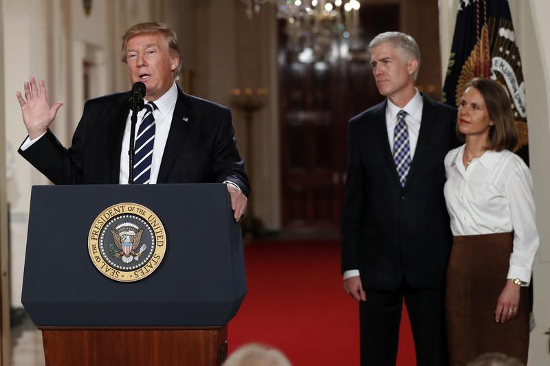 President Donald Trump speaks in the East Room of the White House in Washington to announce Judge Neil Gorsuch as his nominee for the Supreme Court. Gorsuch stands with his wife Louise. (Carolyn Kaster/AP)