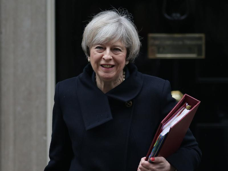 British Prime Minister Theresa May leaves 10 Downing St. on Wednesday. British MPs approved the first stage of a bill empowering her to start pulling the U.K. out of the European Union.