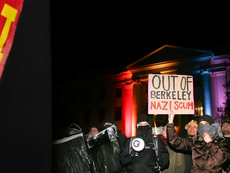 People protest a planned speech by controversial Breitbart editor Milo Yiannopoulos at the University of California, Berkeley, on Wednesday.