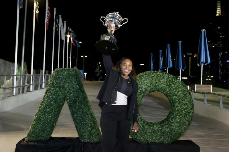 United States' Serena Williams poses with her trophy after defeating her sister Venus to win the women's singles final at the Australian Open tennis championships in Melbourne, Australia. (Aaron Favila/AP)