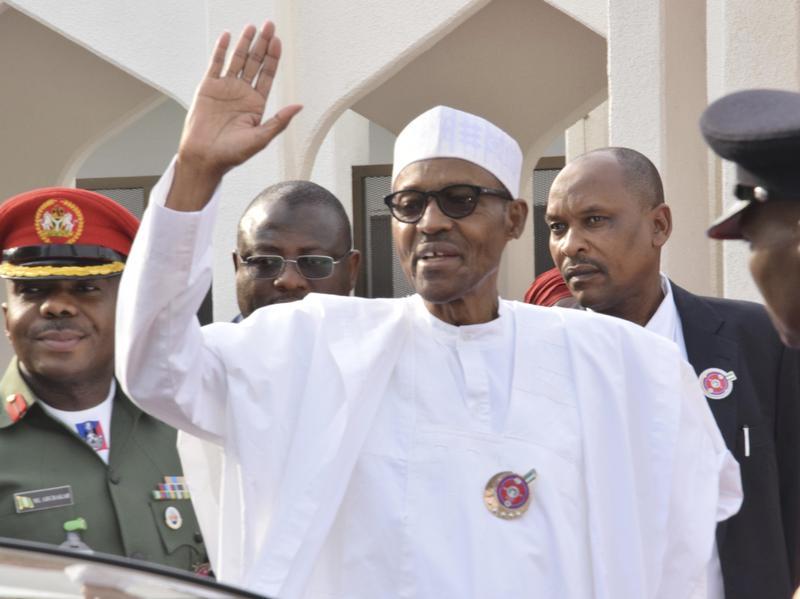 Nigeria President Muhammadu Buhari, waves after a meeting in Abuja, Nigeria, Monday, Jan. 9, 2017.