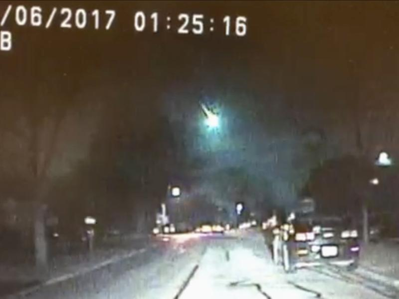 Dashcam video from the Lisle Police Department in Lisle, Ill., captured images of a meteor as it streaked over Lake Michigan early Monday morning.