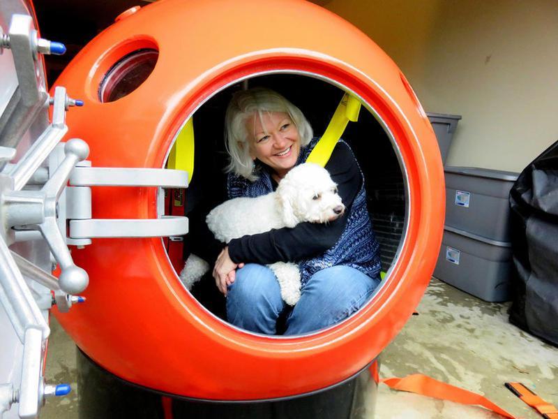 Jeanne Johnson of Ocean Park, Washington, is the first U.S. buyer of a tsunami pod sold by Mukilteo, Washington-based Survival Capsule LLC. (Tom Banse/Northwest News Network)
