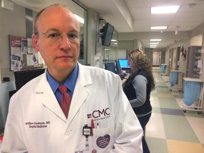 Dr. William Goodman, Chief Medical Officer, stands in Catholic Medical Center's Emergency Department, where 1,033 patients addicted to opioids were seen in 2016. (Jack Rodlico/NHPR)