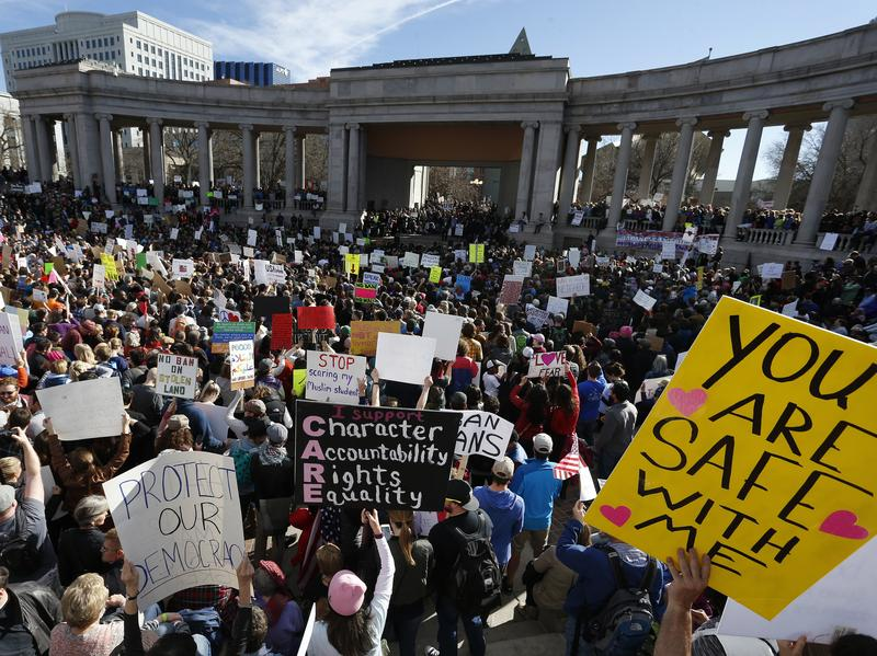 Thousands gather at Denver's City Center Park on Saturday for a rally in support of the Muslim community and to protest President Trump's executive order to temporarily ban some refugees from seven mostly Muslim countries.