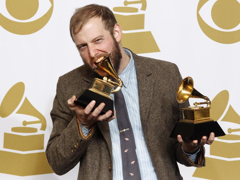 Bon Iver's Justin Vernon bites one of his two Grammy Awards, for Best New Artist and Best Alternative Music Album, at the 54th annual Grammy Awards in February 2012.