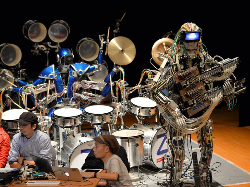 "Robot guitarist ""Mach"" and a robot drummer ""Ashura"", members of a robot rock band ""Z-Machines"", perform music at the National Museum of Emerging Science and Innovation."
