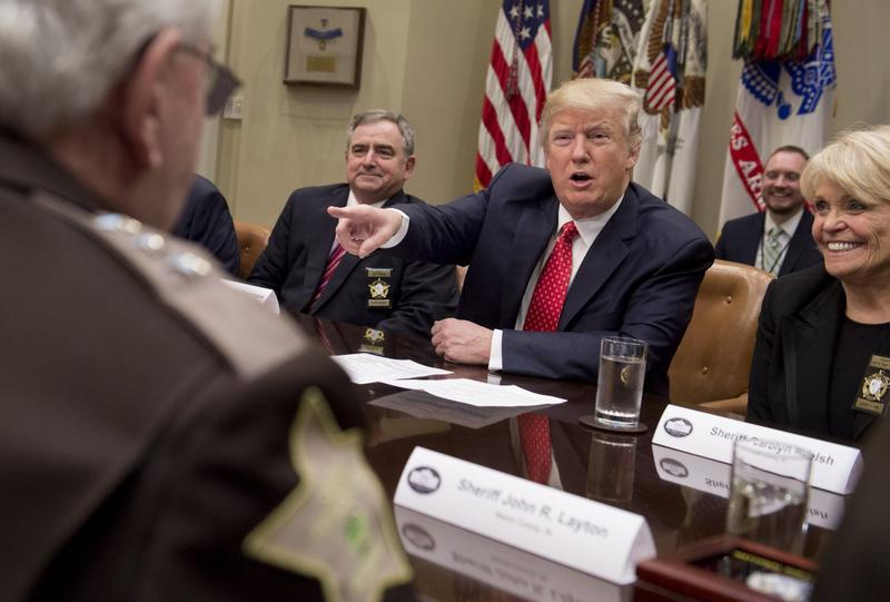 U.S. President Donald Trump speaks alongside Sheriff Carolyn Bunny Welsh (right), of Chester County, Pa., during a meeting with county sheriffs in the Roosevelt Room of the White House in Washington, Feb. 7, 2017. (Saul Loeb/AFP/Getty Images)