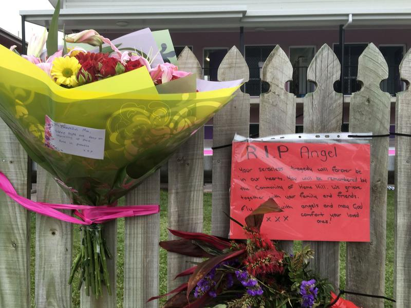 """Flowers and well wishes are placed on a fence outside the hostel where British backpacker Mia Ayliffe-Chung, 21, was stabbed to death last year in a rural Australian community. A Frenchman was charged with her murder and that of another person, but while he allegedly said <em>""""Allahu akbar""""</em> during the attack, police found he showed no signs of radicalization."""
