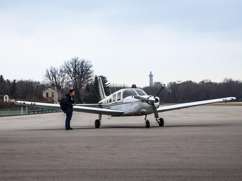 A plane prepares to take off from Put-in-Bay Airport. To get to Put-in-Bay School, some students need to take a plane.