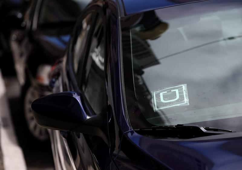 A sticker with the Uber logo is displayed in the window of a car on June 12, 2014 in San Francisco, Calif. (Justin Sullivan/Getty Images)
