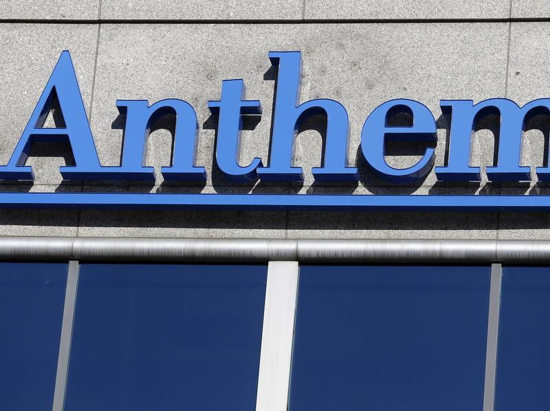 A federal judge has blocked Anthem's bid to merge with another health insurer, Cigna. The Justice Department had said the deal would stifle competition.