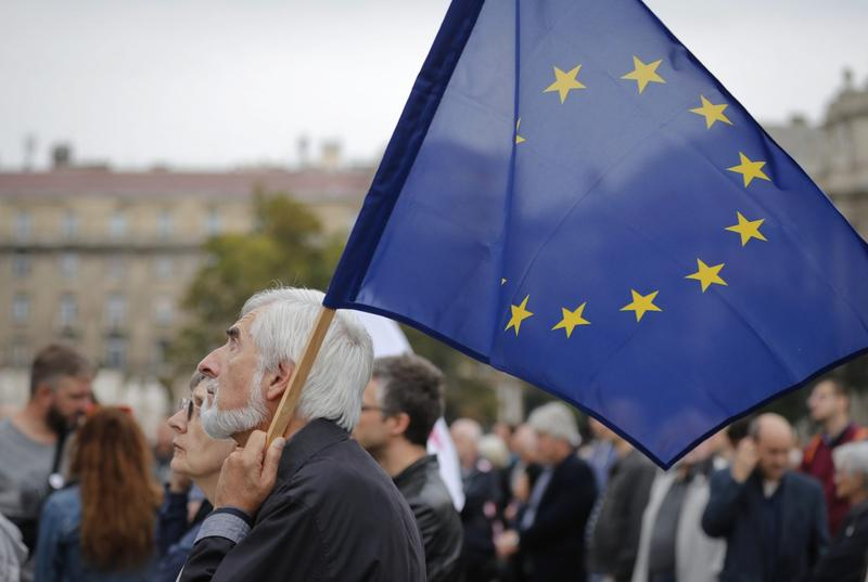 A man holds an European Union flag during a protest by opposition parties against Hungarian Premier Viktor Orban in Budapest, Hungary, in October 2016. (Vadim Ghirda/AP)