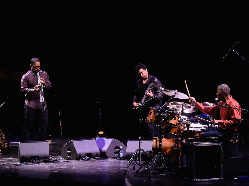 Ravi Coltrane (left) performing with Matthew Garrison (center) and Jack DeJohnette (right) in October. Coltrane is nominated for Best Improvised Jazz Solo at the 2017 Grammy Awards for the title track from <em>In Movement</em>, recorded with Garrison and DeJohnette.