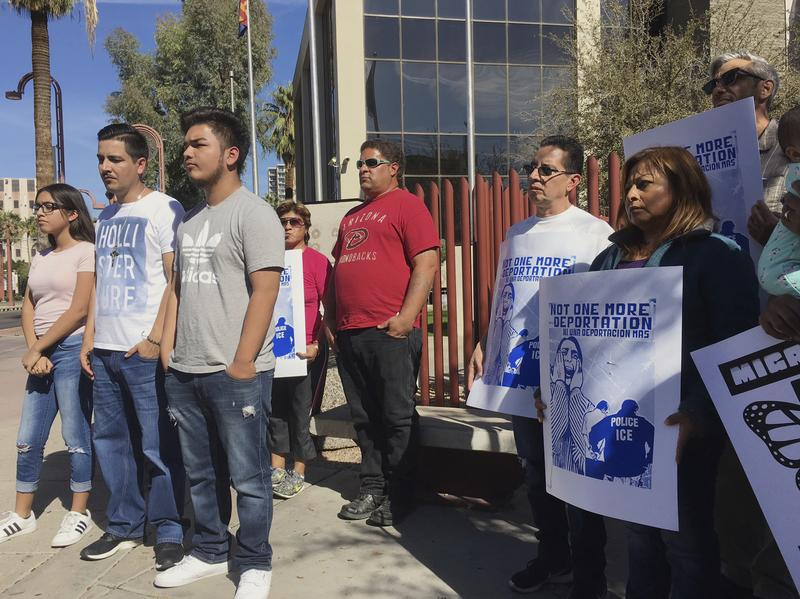 Family members and supporters of Guadalupe Garcia de Rayos gather at a news conference outside the U.S. Immigration and Customs Enforcement office in Phoenix on Thursday.